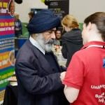 Visitors and stall holders in discussion at the Bolton Health Mela