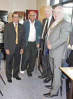 Treasurer Ishwer Tailor, pictured on crutches with Prof Gupta and guests