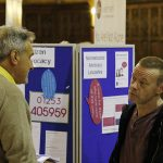 Stall holder and guests in discussion