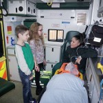Children talking with ambulance crew