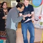 Professor Rajbhandari guiding a Health Olympics health assessor