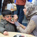 Face painting at the Health Mela