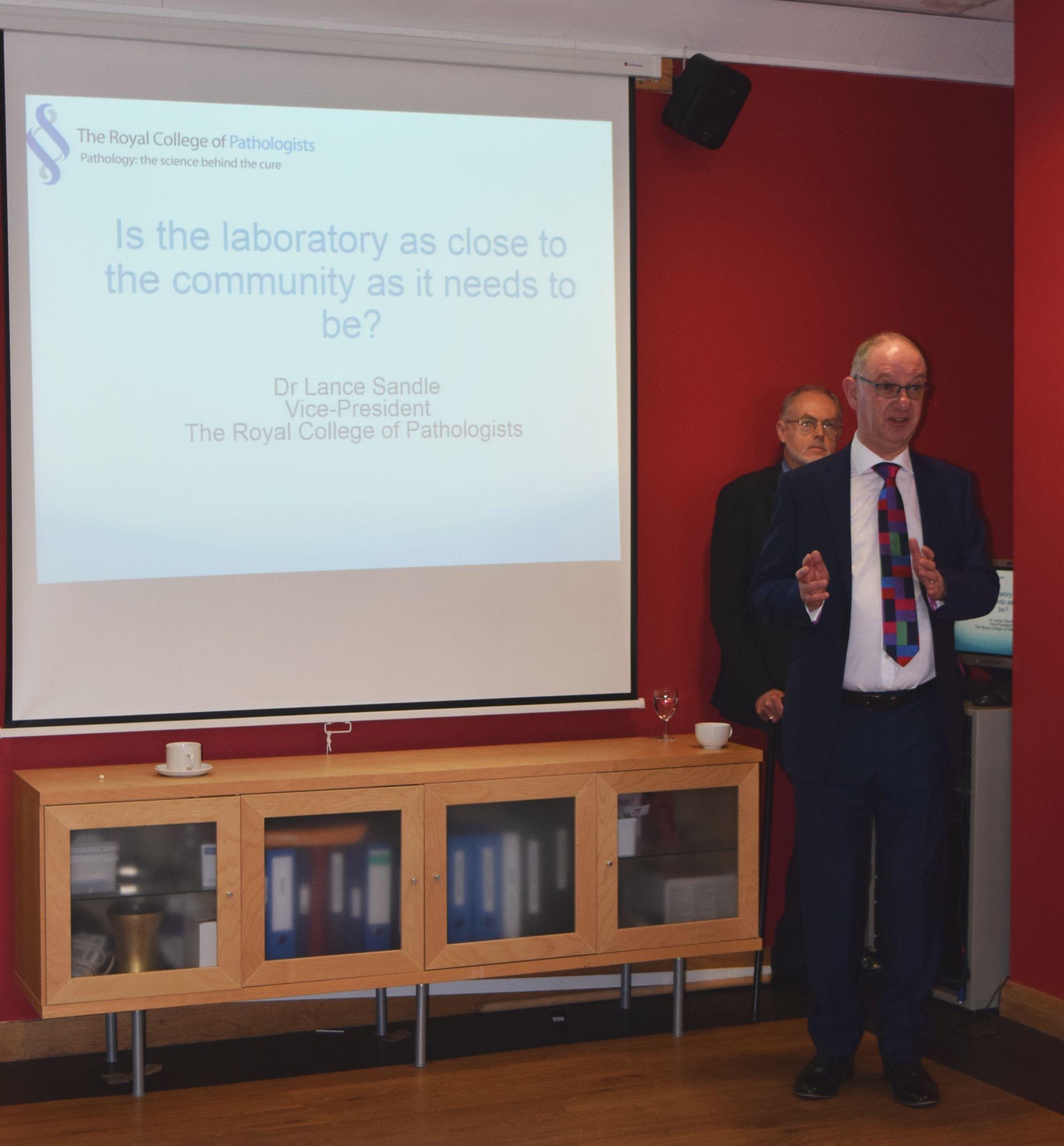 Dr Lance Sandle addresses the meeting