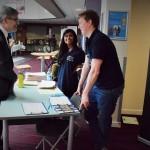 MP Davies talks with Health Olympics volunteers