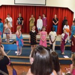 school children present a bollywood themed dance
