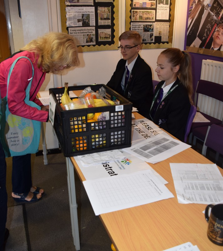 Voluteers manning the registration desk